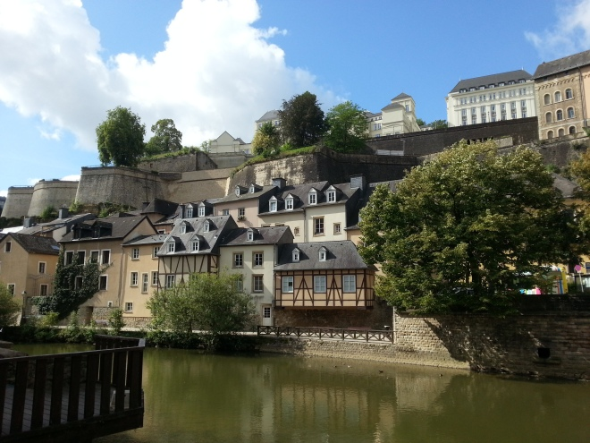 Lovely houses and trees were reflected on the calm water in Grund in Luxembourg