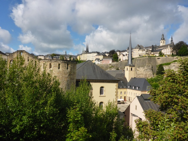 Walking towards Neumünster Abbey and Robert Krieps hall in Luxembourg