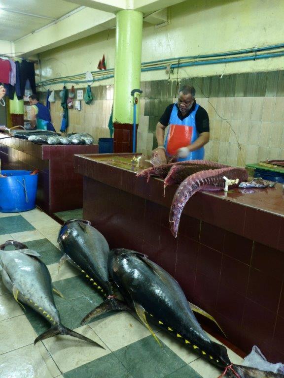 Fishmonger preparing a tuna.