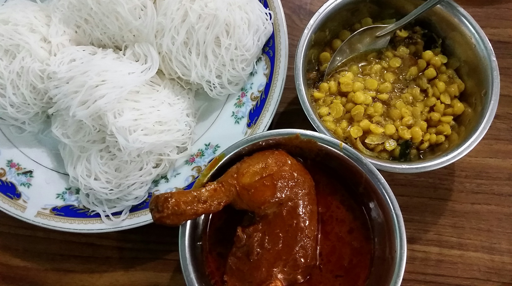 Plain string hoppers with dhal curry and chicken curry.