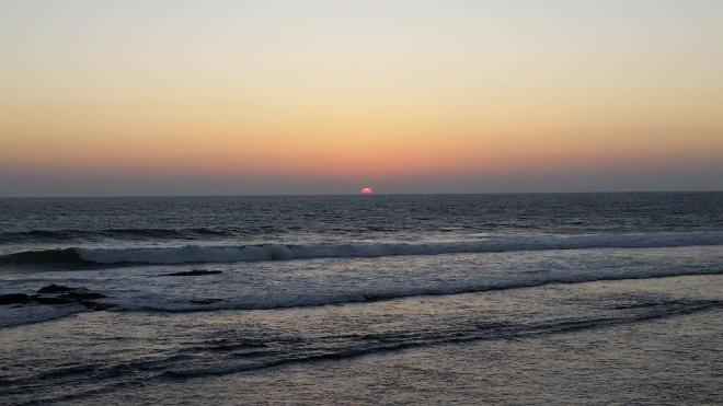 Sun setting in the sea in Galle