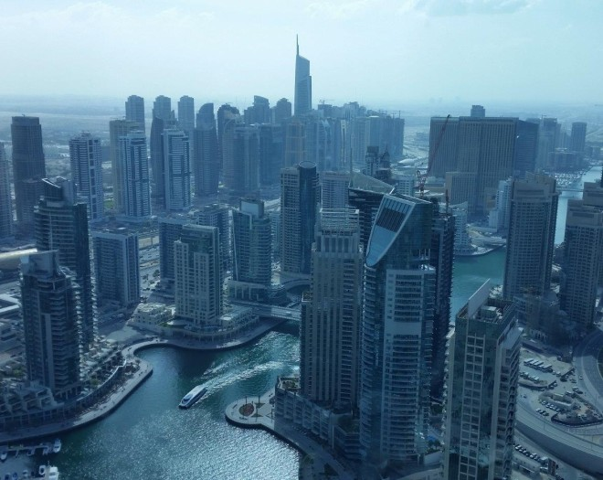 Looking down at the high-raised buildings at Dubai Marina from The Observatory at Dubai Marriott Harbour Hotel & Suites