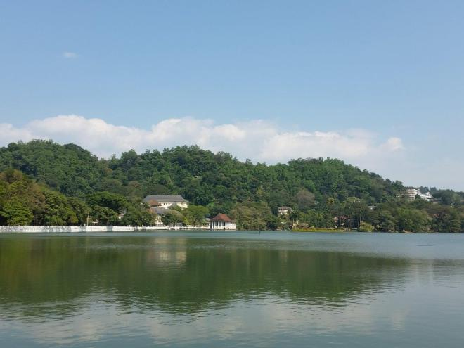 The lake and Temple of The Tooth in Kandy, Sri Lanka