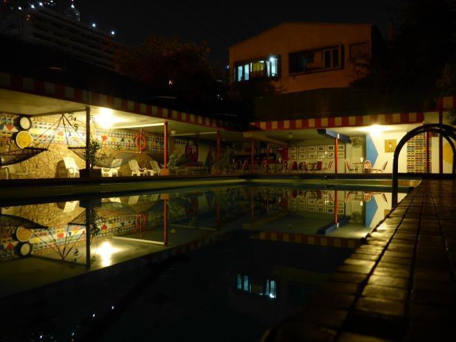 The swimming pool at The Atlanta Hotel in Bangkok