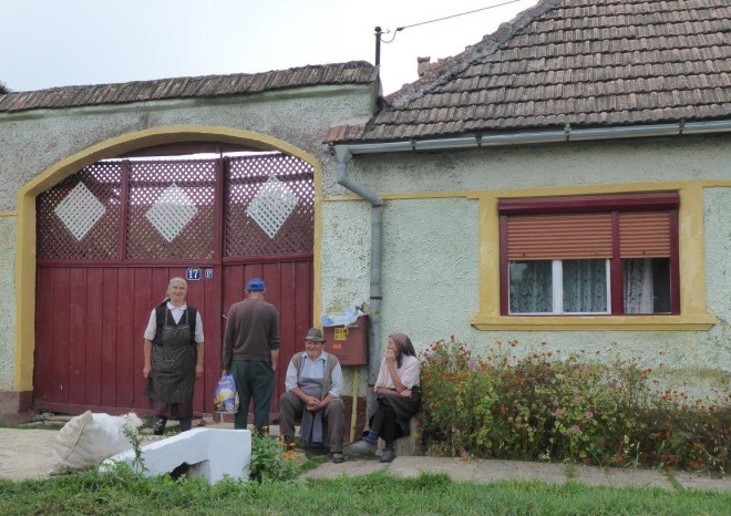 Elderly people outside their houses