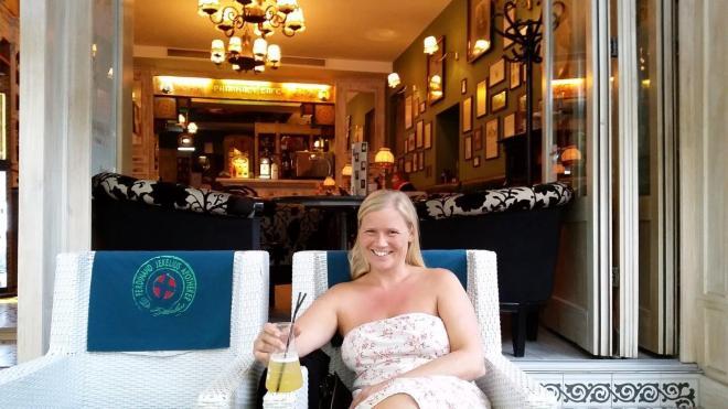 Enjoying tasty drinks from a beaker glas at Dr. Jekelius - Pharmacy Café in Brasov old town