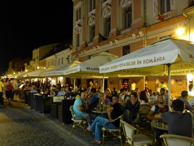 Main pedestrian street in Brasov old town, packed with restaurants