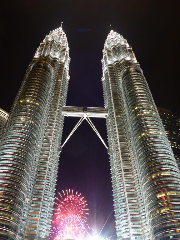 Happy New Year! The fireworks seen from the backside of Petronas Twin Towers in Kuala Lumpur, Malaysia