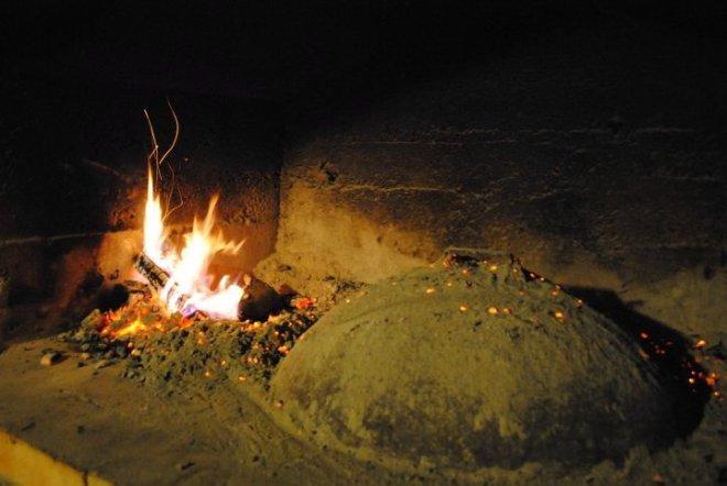 Preparing peka lamb. Croatia