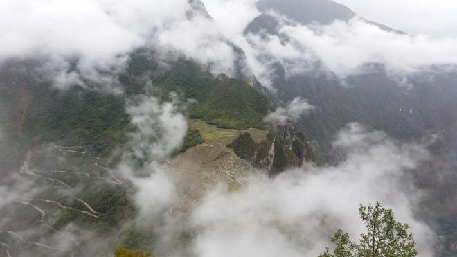 The cloudy carpet revealing Machu Picchu, Peru.