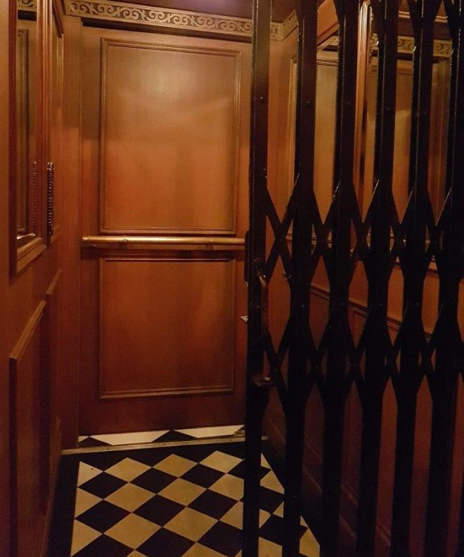 The entrance to ABV through an elevator. Speakeasy bar in Manila, Philippines