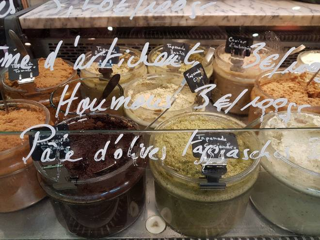 Wide selection of tapenade at Marche d'Aligre. Food tour Paris, France. Withlocals