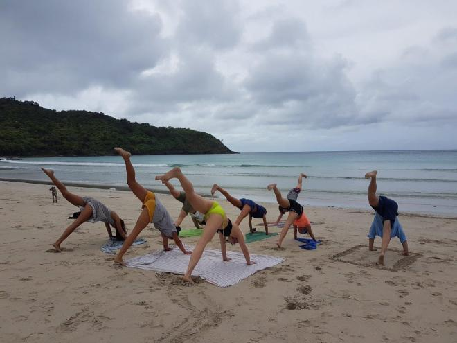 Yoga at the beach. Three day expedition with El Nido Paradise from El Nido to Coron. Philippines.