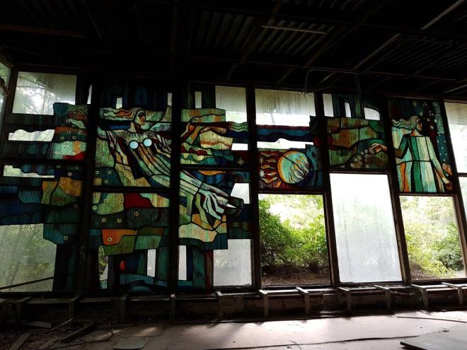 Glass paintings in one of the houses by the river. Pripyat, Chernobyl, Ukraine