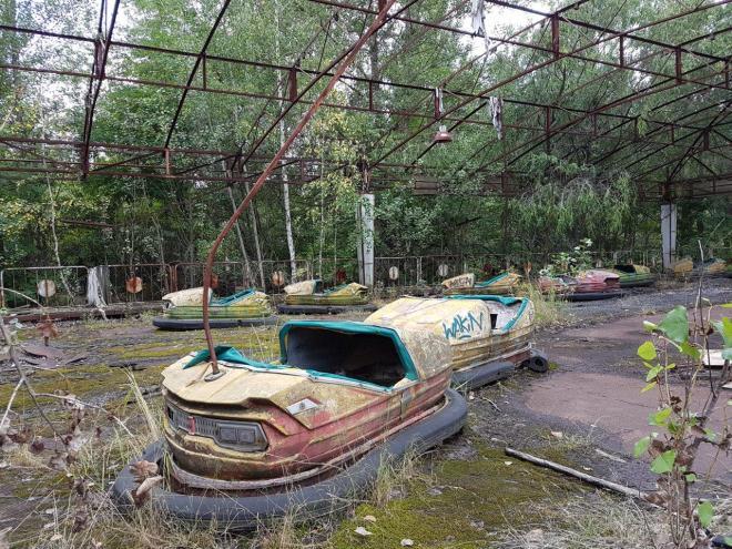 The fading coloured bumper cars in the amusement park. Pripyat, Chernobyl, Ukraine