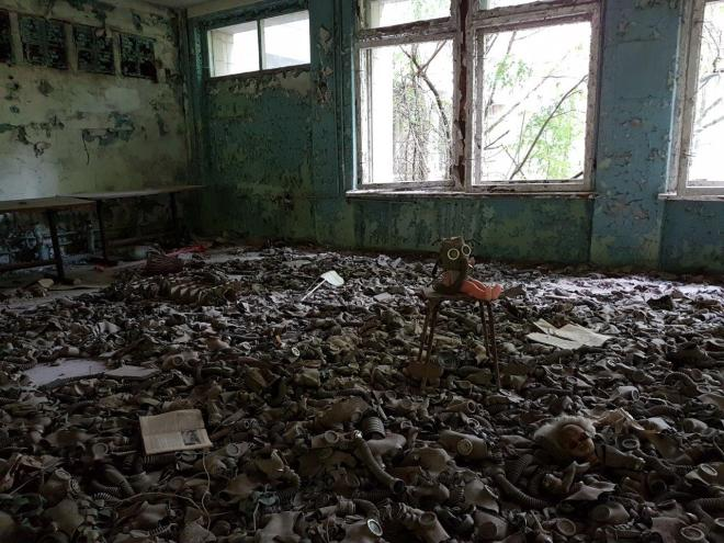 The powerful photo motive of the doll with the gass mask. Pripyat, Chernobyl, Ukraine