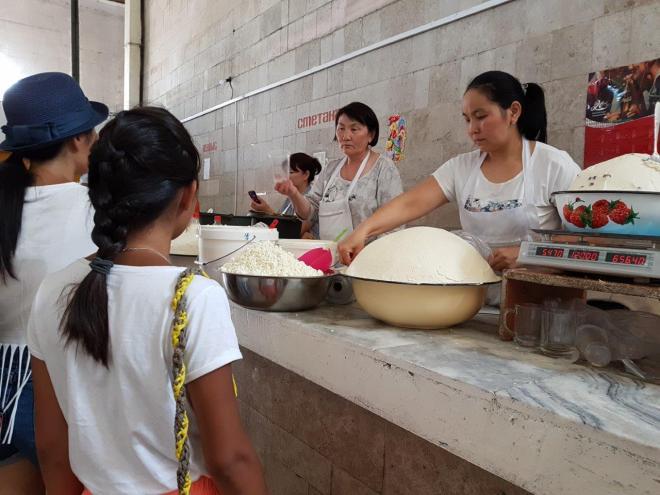 Byshtak - similar to cottage cheese. Osh Bazaar. Food tour in Bishkek, Kyrgyzstan