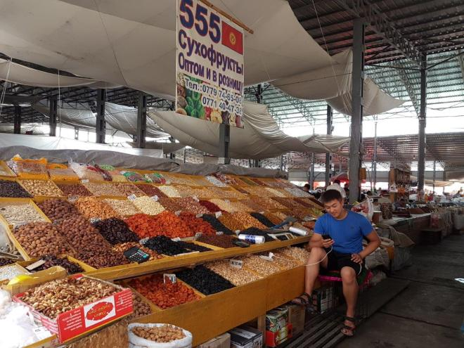 Dried fruites and nuts at Osh Bazaar. Food tour in Bishkek, Kyrgyzstan