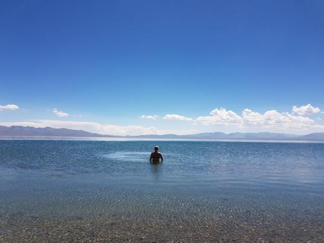 Refreshing bath in Song Kul lake. Three day horse-riding trip to Song Kul, Kyrgyzstan.