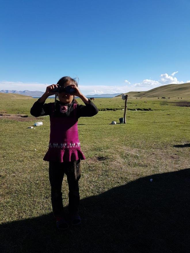 The girl with the binoculars. Three day horse-riding trip to Song Kul, Kyrgyzstan.