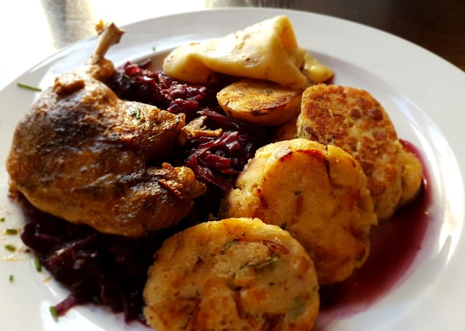 Pečená kačica s lokšami a dusenou červenou kapustou - roast duck served with potato pancakes and steamed red cabbage. Food tour in Bratislava, Slovakia.