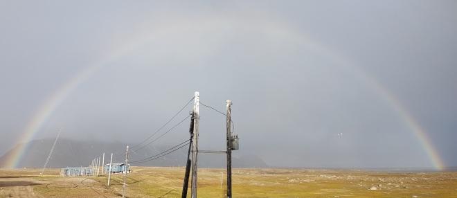 Rainbow at midnight at Isfjord Radio, Svalbard, Norway.