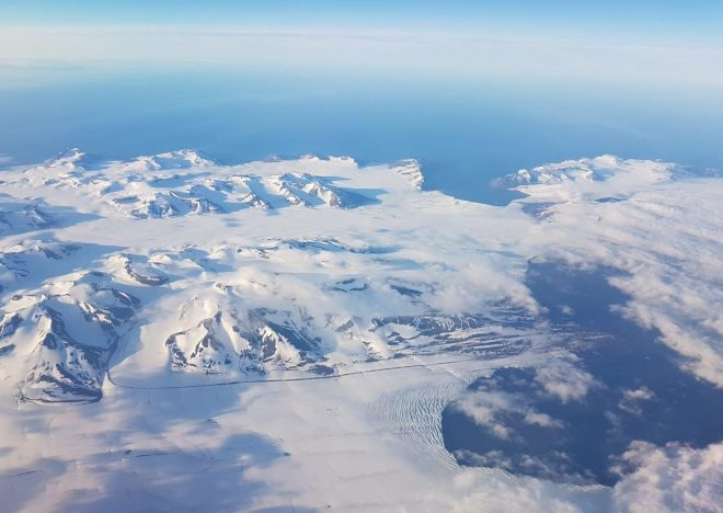 Svalbard from the air around midnight in July. Svalbard, Norway.