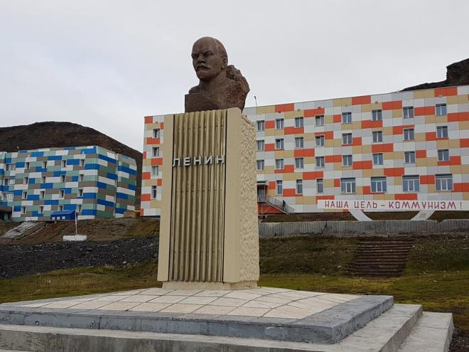 The Lenin statue outside the apartment buildings in Barentsburg. With the sign - Communism is the way of life. Svalbard, Norway.