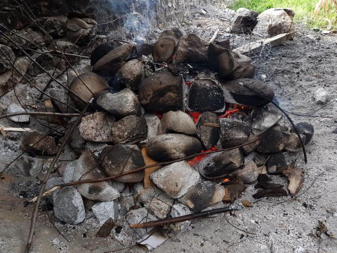 Red hot stones prepared on the fire for the hot stone bath in Paro. Bhutan.