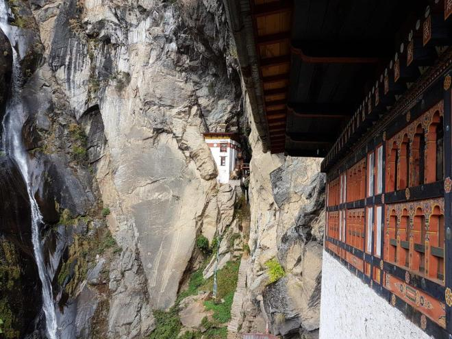 Waterfall and the Lion's Cave at Tiger's Nest. Paro Taktsang. Bhutan.
